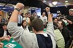 Herman Jango reacts to winning a pot.
