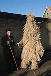 Straw Bear Festival. Whittlesea Whittlesey Cambridgeshire UK 2008. Straw Bear and handler. January Tuesday following Plough Monday.
