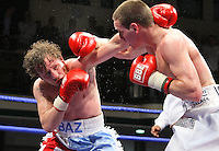Liam Walsh (Cromer, Norfolk, white shorts) defeats Baz Carey (Coventry, light blue/white shorts) in a Lightweight boxing contest at York Hall, Bethnal Green, promoted by Frank Warren / Sports Network - 22/05/09 - MANDATORY CREDIT: Gavin Ellis/TGSPHOTO - Self billing applies where appropriate - 0845 094 6026 - contact@tgsphoto.co.uk - NO UNPAID USE.