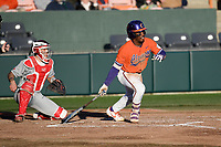 Left fielder Kier Meredith (1) of the Clemson Tigers bats in a game against the Stony Brook Seawolves on Friday, February 21, 2020, at Doug Kingsmore Stadium in Clemson, South Carolina. The Seawolves catcher is John Tuccillo (45). Clemson won, 2-0. (Tom Priddy/Four Seam Images)