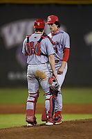 St. John's Red Storm catcher Colin Wetterau (34) chats with relief pitcher Ben Adams (29) on the mound during the game against the Western Carolina Catamounts at Childress Field on March 13, 2021 in Cullowhee, North Carolina. (Brian Westerholt/Four Seam Images)