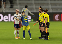 ORLANDO, FL - JANUARY 22: Megan Rapinoe #15 and Daniela Montoya #6 exchange pendants prior to a game between Colombia and USWNT at Exploria stadium on January 22, 2021 in Orlando, Florida.