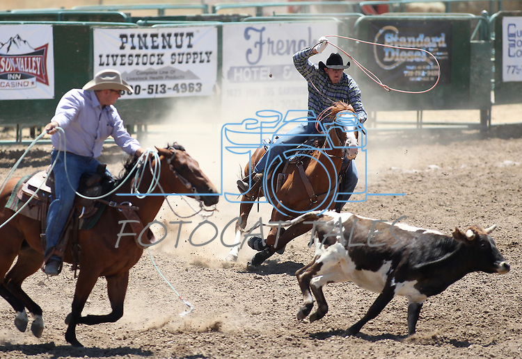 Austin and Trevor Carrasco compete in the team roping event at the Minden Ranch Rodeo on Saturday, July 23, 2011, in Gardnerville, Nev..Photo by Cathleen Allison