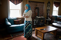 """Shayreen, 16, prays at her home in West Warwick, Rhode Island, USA, on Sunday, Aug. 22, 2011.  Shayreen prays multiple time each day in accordance with her faith. Unlike the rest of her family, Shayreen is very devoted to her Muslim faith.  """"I feel it's my responsibility as a Muslim to be a positive role model,"""" said Shayreen, """"I see a negative energy toward Muslims in the media.""""  Shayreen is will be a high school junior at Lincoln School, an all-girls Quaker school in Rhode Island. The rest of her family is not particularly religious.  When Shayreen began wearing the hijab head covering in her early teens, """"My parents were very supportive, but my aunt tried to talk me out of it. My grandmother was upset.  I was more worried about what my family would think [than what other people would think].""""..photo by: M. Scott Brauer for Education Week"""