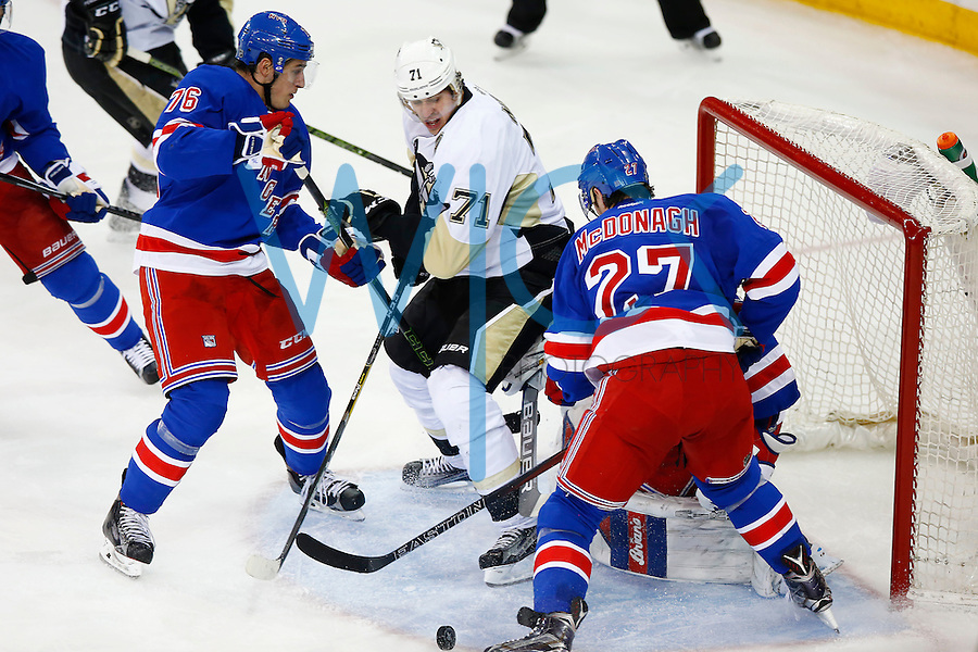 Evgeni Malkin #71 of the Pittsburgh Penguins battles in front of the net for the puck in front of Brady Skjei #76 of the New York Rangers in the second period during game four of the first round of the Stanley Cup Playoffs at Madison Square Garden in New York City on April 21, 2016. (Photo by Jared Wickerham / DKPS)