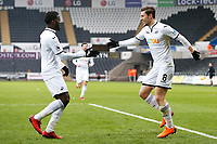 Sunday 18 March 2018<br /> Pictured:  Adnan Maric of Swansea City celebrates scoring his sides second goal of the match with Botti Biabi<br /> Re: Swansea City v Manchester United U23s in the Premier League 2 at The Liberty Stadium on March 18, 2018 in Swansea, Wales.