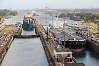 Panama Canal, Panama.  Container Ship and Oil Products Tanker Entering First Lock Heading South, Caribbean in far rear.