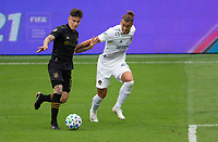 LOS ANGELES, CA - OCTOBER 25: Rolf Feltscher #25 of the Los Angeles Galaxy defending against Brian Rodriguez #17 of LAFC during a game between Los Angeles Galaxy and Los Angeles FC at Banc of California Stadium on October 25, 2020 in Los Angeles, California.