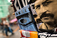 "A t-shirt for sale, depicting the drug lord Pablo Escobar, is seen arranged at the market stand on the street in Medellín, Colombia, 2 December 2017. Twenty five years after Pablo Escobar's death, the legacy of the Medellín Cartel leader is alive and flourishing. Although many Colombians who lived through the decades of drug wars, assassinations, kidnappings, reject Pablo Escobar's cult and his celebrity status, there is a significant number of Colombians who admire him, worshipping the questionable ""Robin Hood"" image he had. Moreover, in the recent years, the popular ""Narcos"" TV series has inspired thousands of tourists to visit Medellín, creating a booming business for many but causing a controversial rise of narco-tourism."