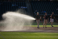 Winston-Salem Dash head groundskeeper Paul Johnson waters the infield prior to the Carolina League game against the Buies Creek Astros at BB&T Ballpark on April 13, 2017 in Winston-Salem, North Carolina.  The Dash defeated the Astros 7-1.  (Brian Westerholt/Four Seam Images)
