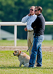Trainer Graham Motion (right) and George Jackson, former owner of Barbaro, watch Animal Kingdom, winner of the 137th Kentucky Derby, as he continues to train for the Belmont Stakes at the Fair Hill Training Center on June 1, 2011 in Fair Hill, Maryland.
