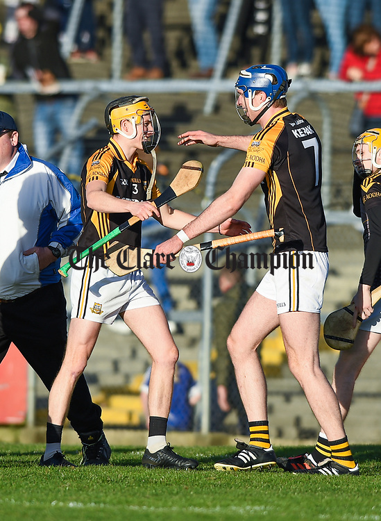 Brian Carrig and Aonghus Keane of Ballyea celebrate following the county senior hurling final against Cratloe at Cusack Park. Photograph by John Kelly.