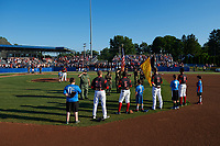 Batavia Muckdogs infielders Ben Fisher (36), Samuel Castro (5), Tyler Curtis (11), and Marcos Rivera (8) stand for the national anthem with young fans, as the flag is being presented by the Vietnam Veterans Chapter 193 out of Warsaw, New York, before a game against the Auburn Doubledays on July 4, 2017 at Dwyer Stadium in Batavia, New York.  Starting pitcher Alex Mateo (37) is at the mound and catcher David Gauntt (7) is at home plate with umpires Jennifer Pawol and Drew Saluga.  Batavia defeated Auburn 3-2.  (Mike Janes/Four Seam Images)