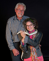 Emile and his wife with a snake at the Herb Lingl Studio Holiday Party, December 30, 2010, Petaluma Municipal Airport, Petaluma, Sonoma County, California