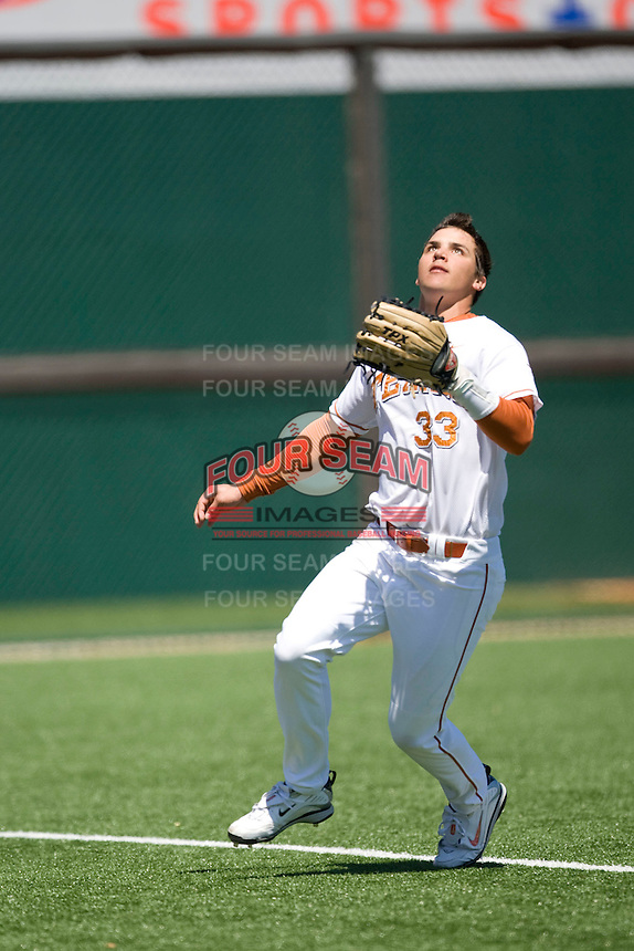 Texas Longhorn Jonathan Walsh makes a sliding catch against Nebraska on Sunday March 21st, 2100 at UFCU Dish-Falk Field in Austin, Texas.  (Photo by Andrew Woolley / Four Seam Images)
