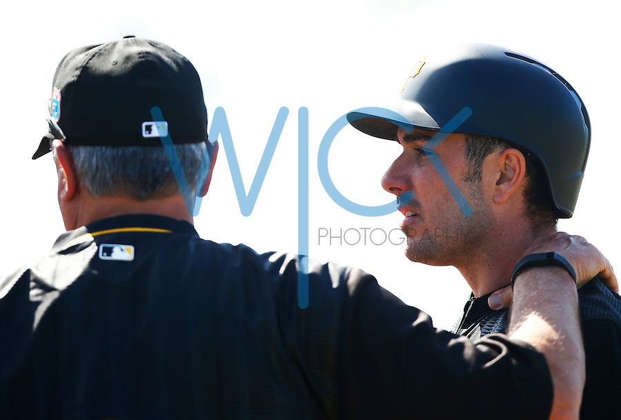 Matt Joyce of the Pittsburgh Pirates talks with manager Clint Hurdle #13 while taking batting practice during spring training at Pirate City in Bradenton, Florida on February 20, 2016. (Photo by Jared Wickerham / DKPS)