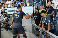 SAINT PAUL, MN - JUNE 23: Michael Boxall #15 of Minnesota United FC celebrates the win with fans after a game between Austin FC and Minnesota United FC at Allianz Field on June 23, 2021 in Saint Paul, Minnesota.