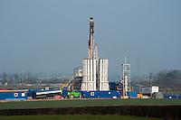 Cuadrilla shale gas drilling rig drills a hole before the service rig prepars for 'fracking' at Singleton, Blackpool, Lancashire. Shale gas is a form of natural gas that is trapped in tiny cracks of rocks buried thousands of feet beneath the surface of the earth..A small company called Cuadrilla Resources became the first in Europe to start drilling for the gas, which has already revolutionised the energy market in America.