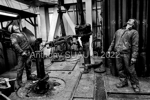 Tengiz, Kazakhstan .1998.Kazak oil workers drill for high-grade oil along side Americans who are working for Chevron near the Caspian Sea. The company plans to invest $20 billions dollars here over the next four decades but the main problem is getting the oil out..