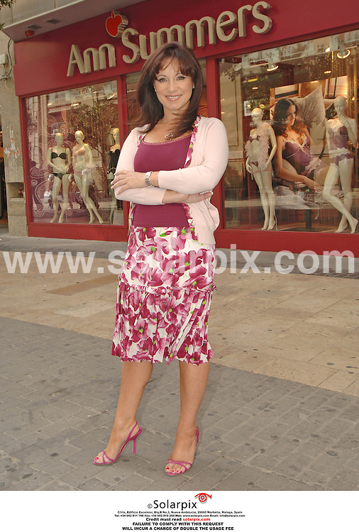 PICTURES FROM SOLARPIX.COM..Jacqueline Gold, owner of Ann summers at her store in Valencia during filming for the brand new LIvingTV show, Break With The Boss...DATE: 13/10/2006-JOB REF: 2920-ITS