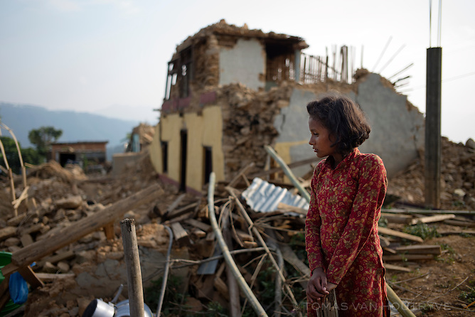 Eleven-year old Sabina Khatri stands in front of her home which was destroyed by earthquake in Kotgaun, in the Kathmandu Valley, Nepal in June 2015. Residents tore down buildings in the hamlet which were too damaged to repair. On June 4th, a team from International Medical Corps built 20 new latrines here and in the neighboring village to help prevent waterborne disease.