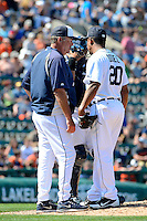 Detroit Tigers pitching coach Jeff Jones talks with pitcher Octavio Dotel #20 during a Spring Training game against the Tampa Bay Rays at Joker Marchant Stadium on March 29, 2013 in Lakeland, Florida.  (Mike Janes/Four Seam Images)