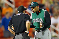 Augusta GreenJackets manager Lipso Nava #17 argues a call with home plate umpire Ramon Hernandez during the South Atlantic League game against the Hickory Crawdads at L.P. Frans Stadium on April 29, 2011 in Hickory, North Carolina.   Photo by Brian Westerholt / Four Seam Images