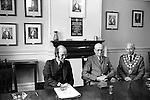 Letting of the Chard Market Tolls. The Guildhall, Chard Somerset. April 1975;<br /> Mayor of Chard, Maurice Lillington, right, past Mayor Ernest Ashman (Mayor 1950-52), centre, and on the left George Smith, an official with the then Yeovil District Council.<br />  A Royal Charter dating back to 29th June 1683 empowered the town to hold three annual fairs and three weekly markets on Tuesdays, Thursdays and Saturdays.  <br /> Historically the right to let the tolls has lain with the burgesses and then Chard Borough Council, but on reorganisation in 1974 the responsibility moved to the new District Council. Chard market tolls are auctioned off against the clock, as sand trickled through an hourglass. After the sand has run out once, the hourglass is turned and further bids could still be made. The sand had to run out a total of three times before the final lessee was decided.<br /> In 1975, the market was held on Boden Street car park, and there were only two or three stalls. ( Four people attended the auction ) Later the site moved to an old Lace Mill, and then they were held in the street. The hourglass auctions ended in the later 1980s because the tolls were becoming more valuable and there were even threats of violence as traders vied with each other.