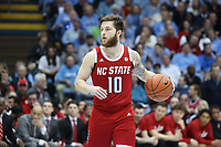 CHAPEL HILL, NC - FEBRUARY 25: Braxton Beverly #10 of North Carolina State University dribbles the ball during a game between NC State and North Carolina at Dean E. Smith Center on February 25, 2020 in Chapel Hill, North Carolina.