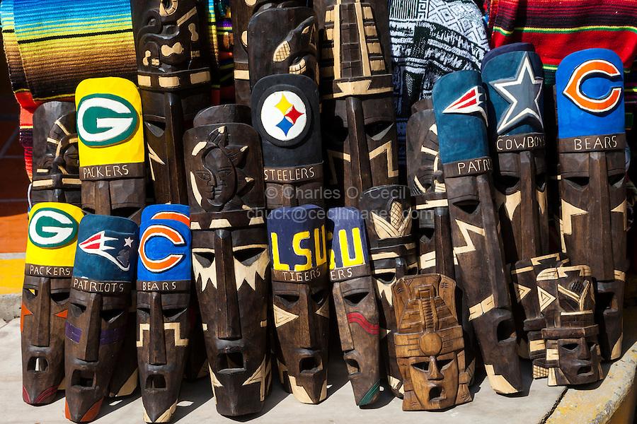 Souvenir Shops Selling Masks with Names of U.S. Football Teams.  Playa del Carmen, Riviera Maya, Yucatan, Mexico.