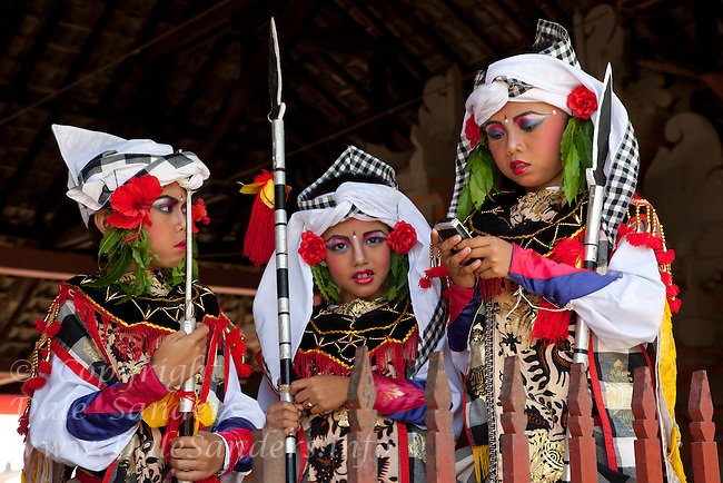 Boys in ancient warrior costumes prepare for a dance at a Balanese Hindu ceremony in Bali, Indonesia.  No Releases