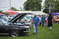 Attendees look at antique cars, Saturday, July 24, 2021 during a farmer's market at Harry Sbanotto Park in Tontitown. The Towntitown Farmer's Market hosted an antique car show and customs exhibit in addition to their regular farmer's market. Check out nwaonline.com/210725Daily/ for today's photo gallery. <br /> (NWA Democrat-Gazette/Charlie Kaijo)