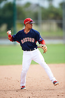 GCL Red Sox third baseman Stanley Espinal (15) throws to first during the first game of a doubleheader against the GCL Rays on August 9, 2016 at JetBlue Park in Fort Myers, Florida.  GCL Rays defeated GCL Red Sox 5-4.  (Mike Janes/Four Seam Images)