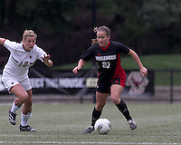 NC State midfielder Ariela Schreibeis (21) controls the ball as Boston College forward/midfielder Gibby Wagner (10) closes. Boston College defeated North Carolina State,1-0, on Newton Campus Field, on October 23, 2011.