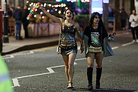 Pictured: Female revellers in Swansea. Tuesday 31 December 2019 to Wednesday 01 January 2020<br /> Re: Revellers on a night out for New Year's Eve in Wind Street, Swansea, Wales, UK.