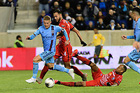 HARRISON, NJ - FEBRUARY 26: Alexander Ring #8 of NYCFC is defended by Pablo Arboine #3 of AD San Carlos during a game between AD San Carlos and NYCFC at Red Bull on February 26, 2020 in Harrison, New Jersey.
