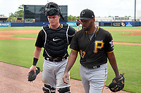 FCL Pirates Black catcher Henry Davis (32) and pitcher Kelvin Disla (67) as they walk to the dugout after the bottom of the fifth inning during a game against the FCL Rays on August 3, 2021 at Charlotte Sports Park in Port Charlotte, Florida.  Davis was making his professional debut after being selected first overall in the MLB Draft out of Louisville by the Pittsburgh Pirates.  (Mike Janes/Four Seam Images)