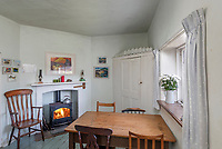 BNPS.co.uk (01202 558833)<br /> Pic: RichardDowner/TheCoastalHouse/BNPS<br /> <br /> Pictured: The dining room.<br /> <br /> An off-grid beachside 'oasis' that has no mains water or electricity is on the market for £550,000.<br /> <br /> The former coastguard cottage is the ultimate retreat for those looking to get away from the modern world - with an outside toilet, 'gravity' shower and no wi-fi.<br /> <br /> It is one of three cottages, built by Napoleonic prisoners of war, above the remote National Trust-owned Mansands Beach, between Kingswear and Brixham in Devon.<br /> <br /> The two-bedroom cottage has spectacular panoramic views of the sea and the South Devon coastline and the three properties also share access to a private cove below.