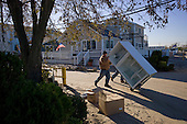 Queens, New York<br /> November 6, 2012<br /> <br /> Rockaway residents assess to their damaged homes in the Rockaway section of the Queens borough New York in the wake of Hurricane Sandy. The beachfront neighborhood was inundated by flood-waters and heavy winds.
