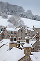 Looking over the roof tops of Bonsall village after heavy snow, Derbyshire, UK. January.