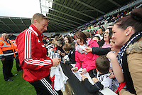 Wednesday, 23 April 2014<br /> Pictured: Head coach Garry Monk signing autographs for supporters.<br /> Re: Swansea City FC are holding an open training session for their supporters at the Liberty Stadium, south Wales,