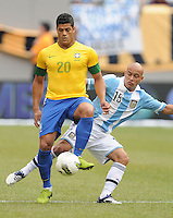 Brazil forward Hulk (20) goes against Argentina defender Clemente Rodriguez (15) The Argentina National Team defeated Brazil 4-3 at MetLife Stadium, Saturday July 9 , 2012.