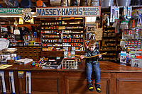 Pictured: Arthur Lewis Jones at the counter Hafod Hardware store in Rhayader, mid Wales, UK. Thursday 05 December 2019.<br /> Re: Shop owner Thomas Lewis Jones has made a Christmas advert starring Arthur Lewis Jones, his two-year-old son costing only £100.<br /> Hafod Hardware in Rhayader, Powys, has been making festive adverts for several years.<br /> This year's advert sees Arthur setting up the shop along with members of his family.