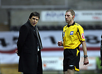 Pictured: Match referee Steve Tanner (R) hands over the items that were thrown to a Coventry City player to stadium security under the watchful eye of Coventry manager Chris Coleman (L).<br /> Re: Coca Cola Championship, Swansea City FC v Coventry City at the Liberty Stadium. Swansea, south Wales, Friday 26 December 2008.<br /> Picture by D Legakis Photography / Athena Picture Agency, Swansea 07815441513