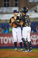 Wilmington Blue Rocks relief pitcher Jacob Bodner (27) talks with catcher Chad Johnson (7) during a game against the Lynchburg Hillcats on June 3, 2016 at Judy Johnson Field at Daniel S. Frawley Stadium in Wilmington, Delaware.  Lynchburg defeated Wilmington 16-11 in ten innings.  (Mike Janes/Four Seam Images)