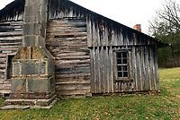 An addition (right) was built on to the original log home.<br />(NWA Democrat-Gazette/Flip Putthoff)