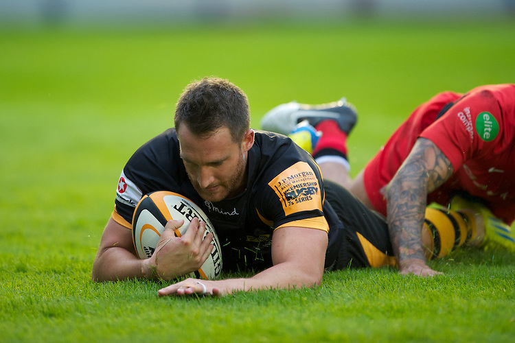 130712 Copyright onEdition 2012 ©.Free for editorial use image, please credit: onEdition..Chris Mayor of London Wasps scores a try against Saracens at The Stoop, Twickenham in the first round of The J.P. Morgan Asset Management Premiership Rugby 7s Series...The J.P. Morgan Asset Management Premiership Rugby 7s Series kicked off again for the third season on Friday 13th July at The Stoop, Twickenham with Pool B being played at Edgeley Park, Stockport on Friday, 20th July, Pool C at Kingsholm Gloucester on Thursday, 26th July and the Final being played at The Recreation Ground, Bath on Friday 3rd August. The innovative tournament, which involves all 12 Premiership Rugby clubs, offers a fantastic platform for some of the country's finest young athletes to be exposed to the excitement, pressures and skills required to compete at an elite level...The 12 Premiership Rugby clubs are divided into three groups for the tournament, with the winner and runner up of each regional event going through to the Final. There are six games each evening, with each match consisting of two 7 minute halves with a 2 minute break at half time...For additional images please go to: http://www.w-w-i.com/jp_morgan_premiership_sevens/..For press contacts contact: Beth Begg at brandRapport on D: +44 (0)20 7932 5813 M: +44 (0)7900 88231 E: BBegg@brand-rapport.com..If you require a higher resolution image or you have any other onEdition photographic enquiries, please contact onEdition on 0845 900 2 900 or email info@onEdition.com.This image is copyright the onEdition 2012©..This image has been supplied by onEdition and must be credited onEdition. The author is asserting his full Moral rights in relation to the publication of this image. Rights for onward transmission of any image or file is not granted or implied. Changing or deleting Copyright information is illegal as specified in the Copyright, Design and Patents Act 1988. If you are in any way unsure of your right to publish this image please co