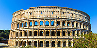 Famous Ancient Roman Colosseum (Flavian Amphitheatre) panorama under a blue sky, in Rome Italy, Southern Europe