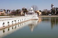 Kathmandu, Nepal.  Rani Pokhari, the Queen's Pond, with Shrine to Shiva.  Clocktower, far right.