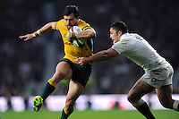 Adam Ashley-Cooper of Australia breaks through the tackle of Brad Barritt of England during the QBE International match between England and Australia at Twickenham Stadium on Saturday 29th November 2014 (Photo by Rob Munro)